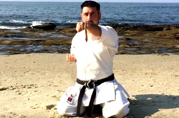 This is a Sensei practicing Karate at the Beach